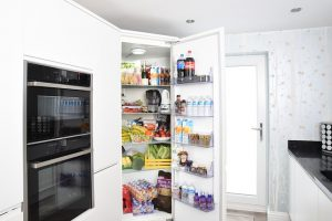 A white refrigerator that needs to be handled with extra care when you need to pack your kitchen in a day