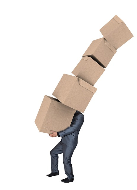 a man carrying boxes, representing guide for a successful moving day