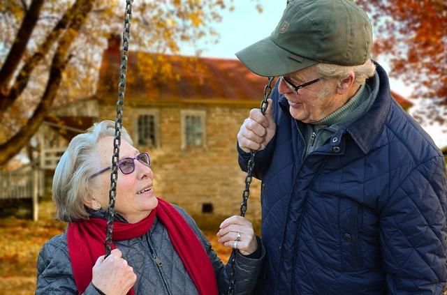 an elderly couple on a swing