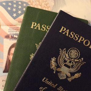 a blue and a green passport