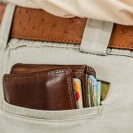 a wallet inside a pocket, representing how to tip your movers