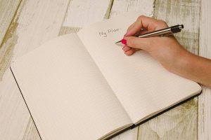 a girl writing down a plan
