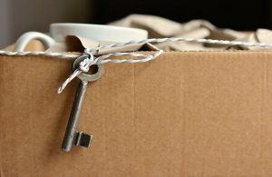A packed box with a key