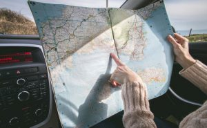 a person holding a map in the car