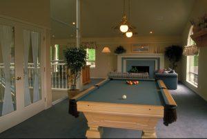 a pool table inside a living room