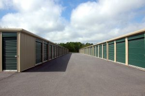 Green storage units pictured in daylight - it's easy to find a perfect storage unit when moving to Tampa