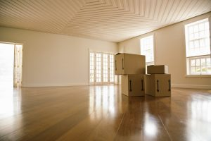 moving boxes inside an empty living room