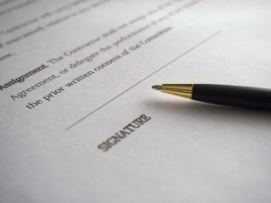 a contract and a pen